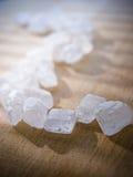 Weiße Kristalle des Zuckers Lizenzfreie Stockfotografie
