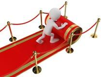 weiße Leute 3D. Arbeitskraft, die den roten Teppich bereitstellt Lizenzfreies Stockbild