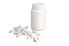 Weiße Medizinflasche und -pillen Stockfoto