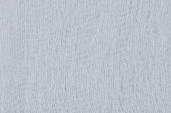 Weiße medizinische Verbandgazebeschaffenheit, Makronahaufnahme des abstrakten strukturierten Hintergrundes, natürliche Baumwollle Lizenzfreie Stockfotos