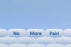 Weiße Pillen auf einem blauen Hintergrund mit dem Wörter ` nicht mehr Schmerz ` Stockfotografie