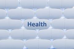 Weiße Pillen mit dem Wort ` Gesundheit ` Stockfotografie