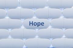 Weiße Pillen mit dem Wort ` Hoffnung ` Stockbilder