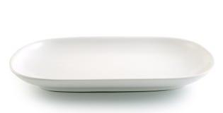 Weiße Platte auf dem weißen Hintergrund Stockfoto