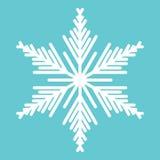 Weiße Schneeflocke auf dem blauen Hintergrund stockbild