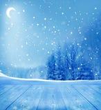 Weiße Schneeflocken auf einem blauen Hintergrund Stockfotos