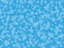 Weiße Schneeflocken auf einem blauen Hintergrund Stockbilder