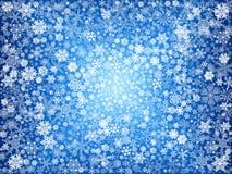 Weiße Schneeflocken im Blau Lizenzfreies Stockbild