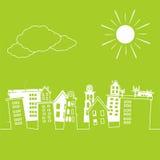 Weiße Stadt auf einem grünen Hintergrund Lizenzfreies Stockfoto
