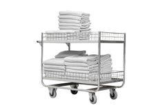 Weiße Tücher auf Laufkatze des Hotels Lizenzfreies Stockfoto