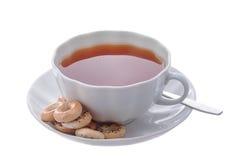 Weiße Tasse Tee und Bagel Stockbild