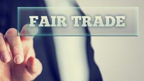 Weiße Texte des fairen Handels auf Glas Stockfoto