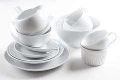 Weiße Tonware- und Küchegeräte Stockfotos