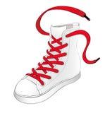 Weiße Turnschuhe mit roten Spitzeen Stockfoto