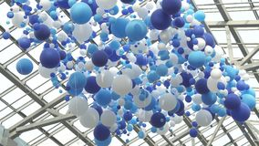 White and blue balloons in the air Stock Footage