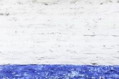 Weiße und blaue Wand des Schmutzes Stockfoto