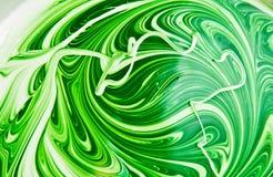 Weiße und grüne Emulsion stockbild