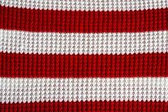 Weiße und rote Wollmusterbeschaffenheit Weihnachtsweihnachtsart Lizenzfreie Stockfotos