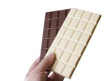 Weiße und schwarze Schokolade stockbilder