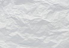 Weiße zerknitterte Papierhintergrundbeschaffenheit Stockfotos