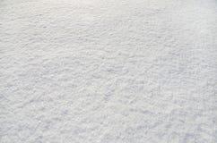 Weißer flaumiger Schnee wie ein Hintergrund stockbild