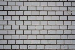 Weißer grauer Wandziegelsteinhintergrund in Japan Lizenzfreie Stockfotografie