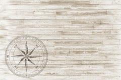Weißer hölzerner Hintergrund der Weinlese mit Kompass Lizenzfreies Stockfoto