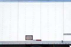 Weißer Lieferwagen mit leerer Seite Lizenzfreie Stockfotos