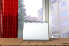 Weißer Loseblattkalenderspott oben vor unscharfem Hintergrund Illustration 3d des leeren Tischkalenders Stockfotos