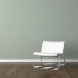 Weißer moderner Stuhl auf grüner Wand stock abbildung