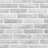Weißer nahtloser Hintergrund der Ziegelsteinsteinwand Lizenzfreies Stockfoto