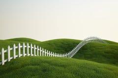Weißer Pfostenzaun auf Gras Lizenzfreie Stockfotografie
