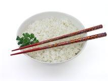 Weißer Reis und Ess-Stäbchen Stockfotos