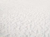 Weißer Sandhintergrund stockbilder