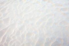 Weißer Sandhintergrund lizenzfreie stockfotografie
