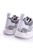 Weißer schwarzer Störschub Camo Adidass NMD R1 Primeknit Oreo Stockfotografie