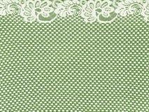 Weißer Spitzerand auf grünem Hintergrund Stockbild