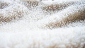 Weißer Strickjackenbeschaffenheitshintergrund Stockfoto