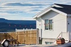 Weißes Abstellgleis-Isländer-Haus Stockbild
