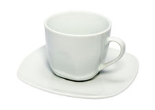 Weißes Cup auf einem quadratischen Saucer Stockfotos