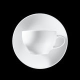 Weißes Cup auf schwarzem Hintergrund lizenzfreies stockfoto