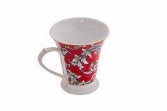 Weißes Cup auf weißem Hintergrund Stockbild