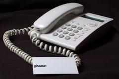 Weißes Geschäftstelefon auf Tabelle. Lizenzfreies Stockbild