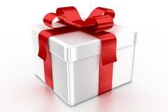 Weißes Geschenk mit rotem Farbband stockbild