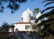 Weißes Haube-Haus-Dach Stockbild