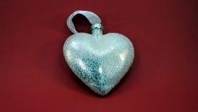 Weißes Herz mit glänzendem Stockbilder