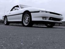Weißes Import-Sport-Auto 80s Lizenzfreies Stockbild