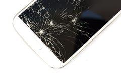 Weißes intelligentes Telefon gebrochen auf weißem Isolathintergrund Stockbild