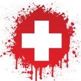 Weißes Kreuz im roten Spritzen Lizenzfreie Stockfotografie