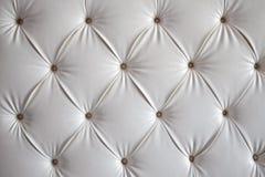 Weißes Leder-Sofa-Hintergrund Stockfoto